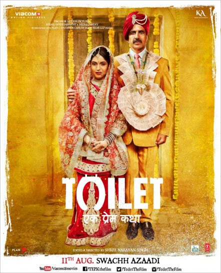 Akshay Kumar is easily one of the biggest actors in Bollywood that continues to push boundaries with his work. While not all of his films are super hit successes, one can't accuse the guy of being successful by repeating the same formula over and over. His next movie, 'Toilet: Ek Prem Katha' is probably the farthest from a formula imaginable. Akshay Kumar's 'Toilet: Ek Prem Katha' brings up an issue that many may not know even exists. Like every Bollywood movie, this one is a love story. But with a weird twist. The trailer shows us a man whose zodiac is not ideal for marriage. Because that's a thing that Hindus believe in. The astrologist must analyze and approve of one's horoscope to deem them worthy of marriage. Akshay Kumar is not worthy at all. However, his luck changes when he meets Bhumi Pednekar and love ensues. The first half of the trailer is very typical, with a cute-meet, what look like interesting song sequences and eventual marriage. Good times for all. The twist comes after, and all in all, it may be a shocking one for non Resident Indian audiences. After her first night with her new husband, Pednekar realizes that the village she's married into, has no toilets. The women wake up before dawn, and march into the woods with... bowls (?) to... do their business. Yep. Padnekar's character is probably about as shocked at this as you are at this point. The village has no toilets. Apparently it's an accepted thing about how impure it is to do potty in the same house as where one prays and so on. It seems like Pednekar's character is from the city, probably a bit more educated and westernized than the inhabitants of the village. So she has, let's say a problem, with this situation. She's having none of it! This becomes a deal breaker in her marriage to Kumar, and then the Trailer takes an even weirder turn. The film is, seemingly, about one man's crusade to build a toilet in his village, so he may reunite with his wife. A crapper of love! In essense. 'Toilet: 